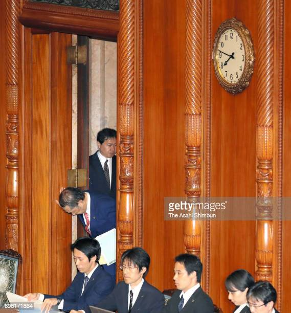 Justice Minister Katsutoshi Kaneda bows prior to leaving the chamber after the Upper House passes the anticonspiracy legislation at the Diet building...