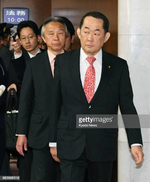 Justice Minister Katsutoshi Kaneda leaves a Diet chamber in Tokyo on May 17 after opposition parties submitted a noconfidence motion against him...