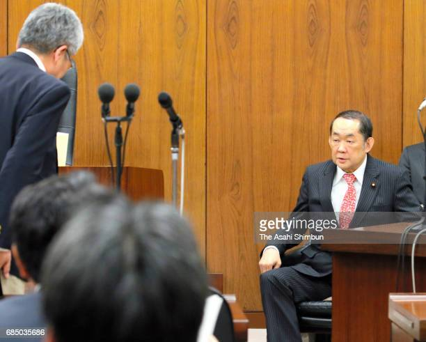 Justice Minister Katsutoshi Kaneda reacts after opposition party lawmakers leave the room after submitting a noconfidence motion at the lower house...