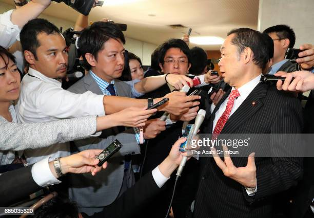 Justice Minister Katsutoshi Kaneda speaks to media reporters after opposition parties submitted the noconfidence motion at the diet building on May...