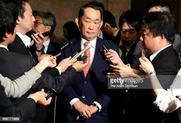 Justice Minister Katsutoshi Kaneda speaks to media reporters after the Upper House passes the anticonspiracy legislation at the Diet building on June...