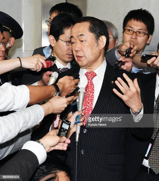 Justice Minister Katsutoshi Kaneda speaks to reporters in Tokyo on May 17 after opposition parties submitted a noconfidence motion against him...