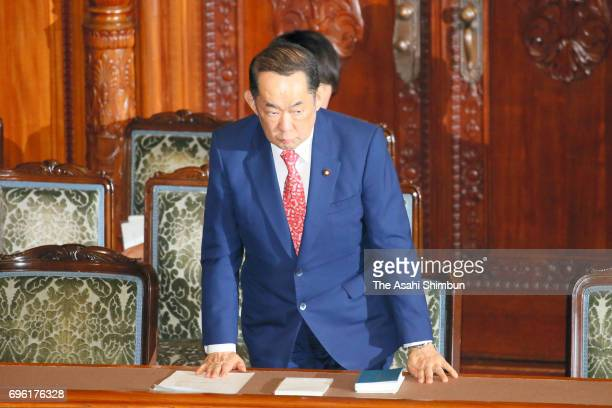 Justice Minister Katsutoshi Kaneda stands to bow after the censure motion against him was voted down at an Upper House plenary session on June 14...