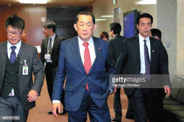 Justice Minister Katsutoshi Kaneda walks to attend an Upper House Justice Committee at the Diet building on April 6 2017 in Tokyo Japan Debate has...