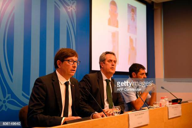 Justice Minister of the Catalan Government Carles Mundo speaks past Josep Lluis Trapero chief of the Catalan regional police 'Mossos D'Esquadra' and...