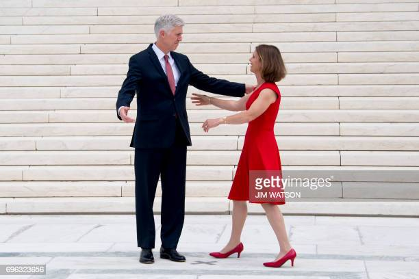 Justice Neil Gorsuch greets his wife Marie Louise Gorsuch on the steps of the US Supreme Court in Washington DC June 15 2017 / AFP PHOTO / JIM WATSON