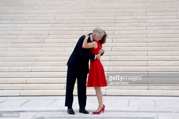 Justice Neil Gorsuch is hugged by his wife Marie Louise Gorsuch on the steps of the US Supreme Court in Washington DC June 15 2017 / AFP PHOTO / JIM...