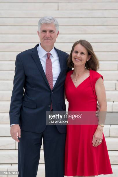 Justice Neil Gorsuch stands with his wife Marie Louise Gorsuch on the steps of the US Supreme Court in Washington DC June 15 2017 / AFP PHOTO / JIM...