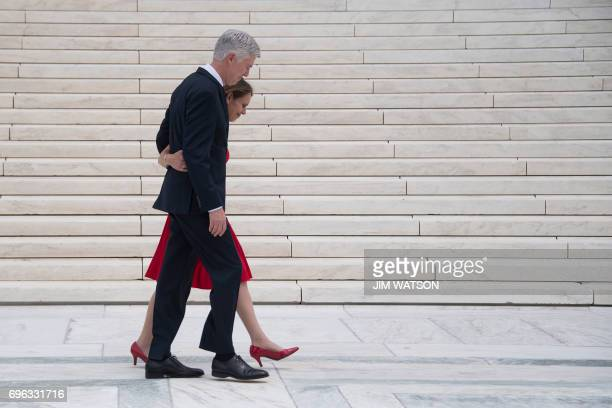 Justice Neil Gorsuch walks with his wife Marie Louise Gorsuch on the steps of the US Supreme Court in Washington DC June 15 2017 / AFP PHOTO / JIM...