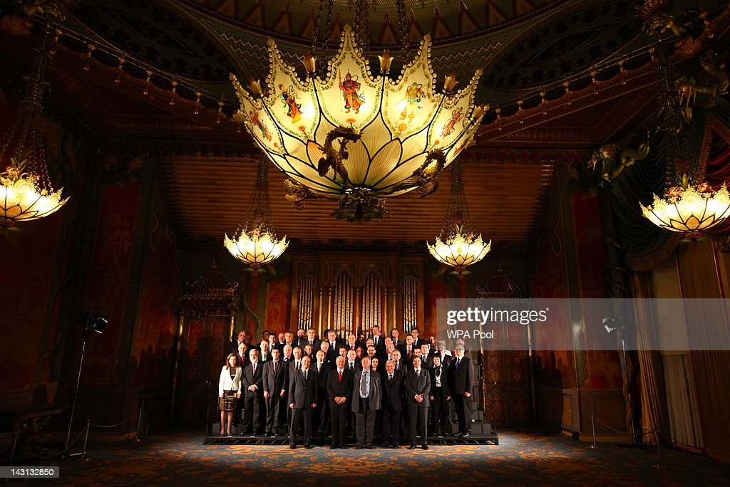 Justice Secretary Ken Clarke poses with the 47 members of the Council of Europe for a family photograph at the Royal Pavilion during the Council of...