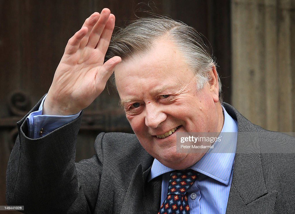 Justice Secretary Ken Clarke waves to photographers as he arrives at The Royal Courts of Justice give evidence to The Leveson Inquiry on May 30 2012...
