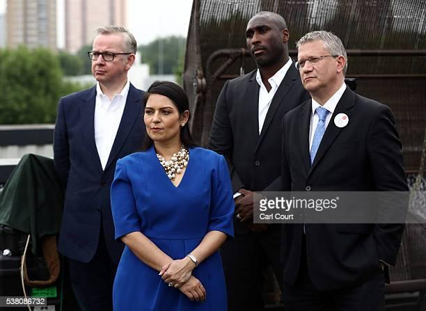 Justice Secretary Michael Gove Employment Secretary Priti Patel former England footballer Sol Campbell and Andrew Rosindell MP listen as Boris...