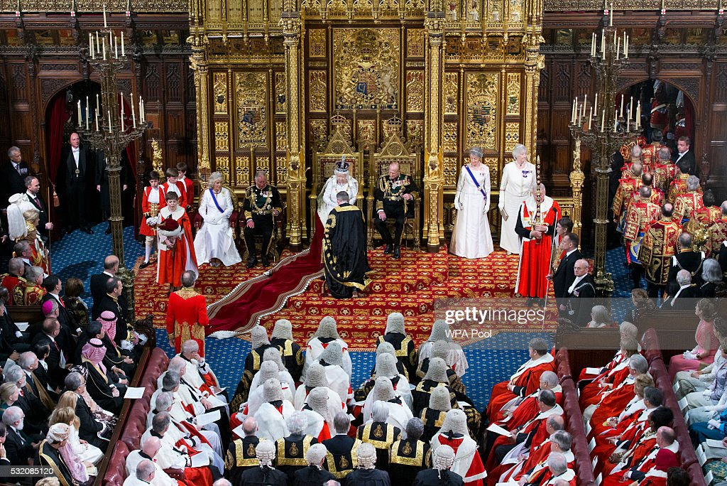 Justice Secretary Michael Gove kneels before Queen Elizabeth II after she delivered the Queen's Speech from the throne as Prince Philip Duke of...