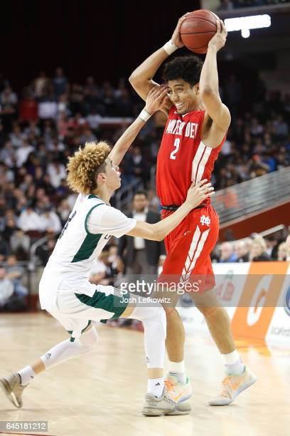 Justice Sueing of Mater Dei High School looks to pass the ball while being guarded by LaMelo Ball of Chino Hills High School during the game against...