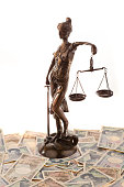 Justice with scales and Yen banknotes