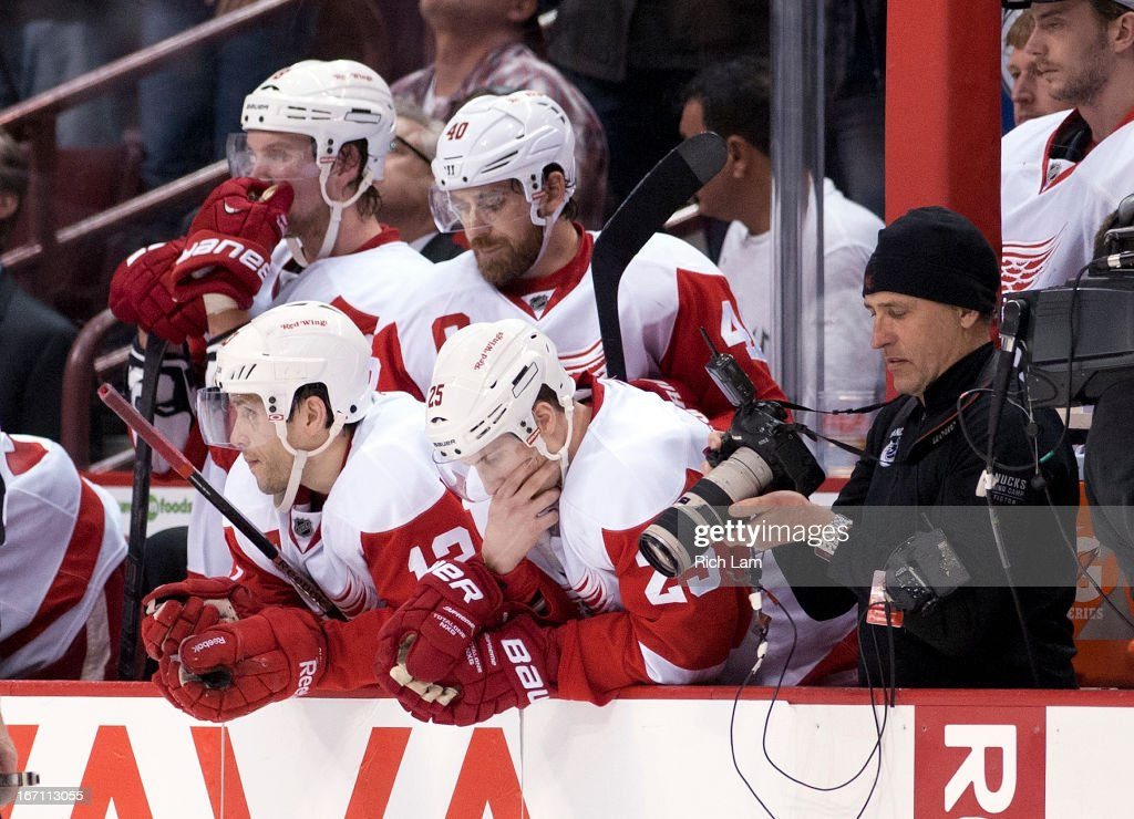 <a gi-track='captionPersonalityLinkClicked' href=/galleries/search?phrase=Justin+Abdelkader&family=editorial&specificpeople=2271858 ng-click='$event.stopPropagation()'>Justin Abdelkader</a> #8, <a gi-track='captionPersonalityLinkClicked' href=/galleries/search?phrase=Henrik+Zetterberg&family=editorial&specificpeople=201520 ng-click='$event.stopPropagation()'>Henrik Zetterberg</a> #40, <a gi-track='captionPersonalityLinkClicked' href=/galleries/search?phrase=Pavel+Datsyuk&family=editorial&specificpeople=202893 ng-click='$event.stopPropagation()'>Pavel Datsyuk</a> #13 and <a gi-track='captionPersonalityLinkClicked' href=/galleries/search?phrase=Cory+Emmerton&family=editorial&specificpeople=570505 ng-click='$event.stopPropagation()'>Cory Emmerton</a> #25 of the Detroit Red Wings react on the bench after Maxim Lapierre #40 of the Vancouver Canucks scored during shootout in NHL action on April 20, 2013 at Rogers Arena in Vancouver, British Columbia, Canada. The Red Wings lost 2-1 to the Canucks.