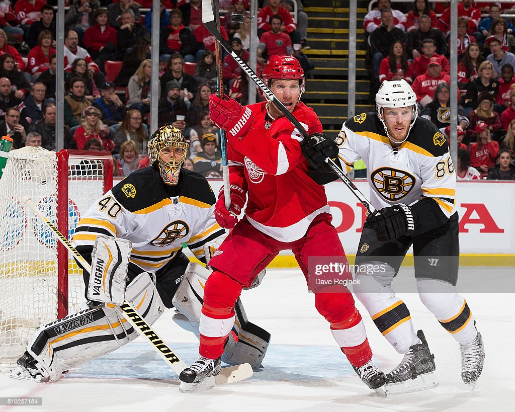 <a gi-track='captionPersonalityLinkClicked' href=/galleries/search?phrase=Justin+Abdelkader&family=editorial&specificpeople=2271858 ng-click='$event.stopPropagation()'>Justin Abdelkader</a> #8 of the Detroit Red Wings battles for position with <a gi-track='captionPersonalityLinkClicked' href=/galleries/search?phrase=Kevan+Miller&family=editorial&specificpeople=8236132 ng-click='$event.stopPropagation()'>Kevan Miller</a> #86 of the Boston Bruins in front of <a gi-track='captionPersonalityLinkClicked' href=/galleries/search?phrase=Tuukka+Rask&family=editorial&specificpeople=716723 ng-click='$event.stopPropagation()'>Tuukka Rask</a> #40 of the Bruins during an NHL game at Joe Louis Arena on February 14, 2016 in Detroit, Michigan.