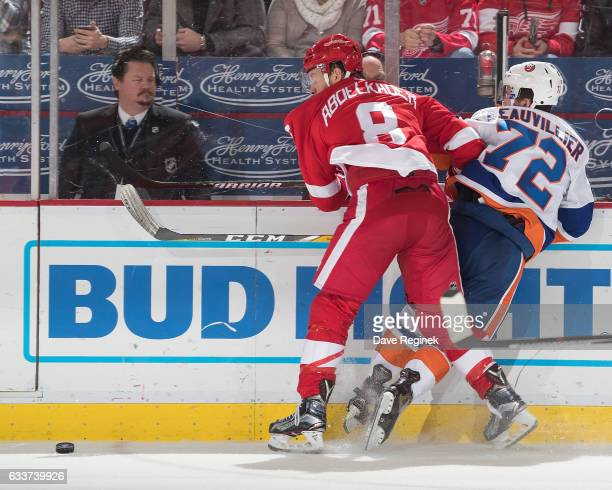 Justin Abdelkader of the Detroit Red Wings battles for the puck along the boards with Anthony Beauvillier of the New York Islanders during an NHL...