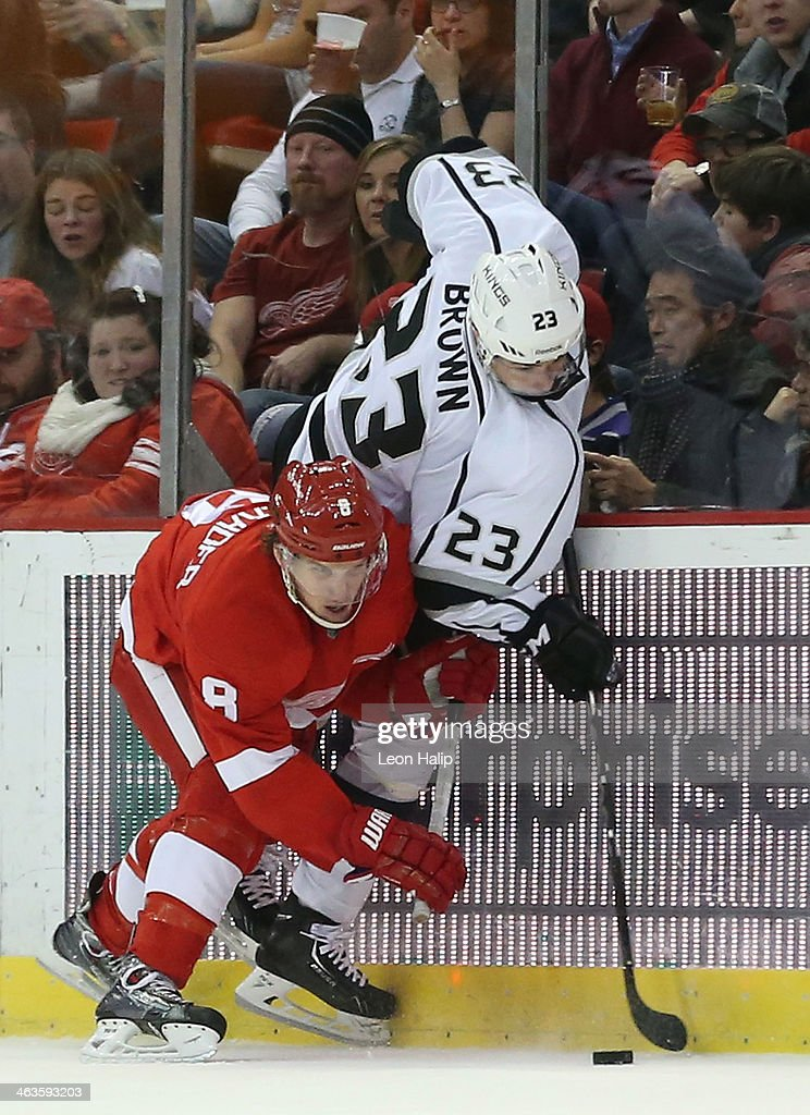 <a gi-track='captionPersonalityLinkClicked' href=/galleries/search?phrase=Justin+Abdelkader&family=editorial&specificpeople=2271858 ng-click='$event.stopPropagation()'>Justin Abdelkader</a> #8 of the Detroit Red Wings battles for the puck against Dustin Brown #23 of the Los Angeles Kings during the third period of the game at Joe Louis Arena on January 18, 2014 in Detroit, Michigan. The Wings defeated the Kings 3-2 in a shootout.