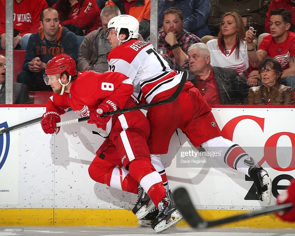 <a gi-track='captionPersonalityLinkClicked' href=/galleries/search?phrase=Justin+Abdelkader&family=editorial&specificpeople=2271858 ng-click='$event.stopPropagation()'>Justin Abdelkader</a> #8 of the Detroit Red Wings checks <a gi-track='captionPersonalityLinkClicked' href=/galleries/search?phrase=Brett+Bellemore&family=editorial&specificpeople=4270909 ng-click='$event.stopPropagation()'>Brett Bellemore</a> #73 of the Carolina Hurricanes against the boards during an NHL game on April 11, 2014 at Joe Louis Arena in Detroit, Michigan.