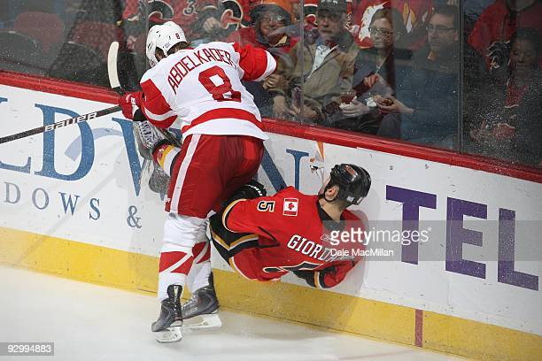 Justin Abdelkader of the Detroit Red Wings checks Mark Giordano of the Calgary Flames during their game on October 31 2009 at the Pengrowth...
