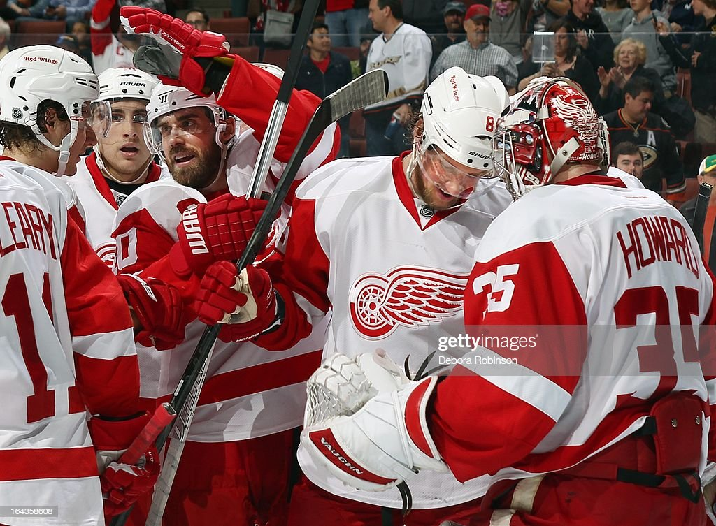 Justin Abdelkader #8 of the Detroit Red Wings congratulates goalie Jimmy Howard #35 after the win over the Anaheim Ducks. Justin Abdelkader #8 scored a hat trick during the winning performance. March 22, 2013 at Honda Center in Anaheim, California.
