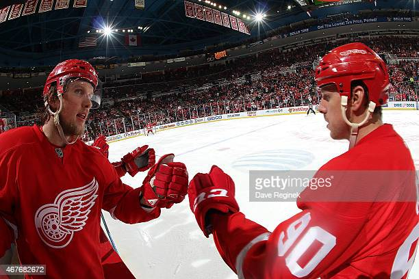Justin Abdelkader of the Detroit Red Wings congratulates teammate Stephen Weiss for scoring a goal during a NHL game against the San Jose Sharks on...