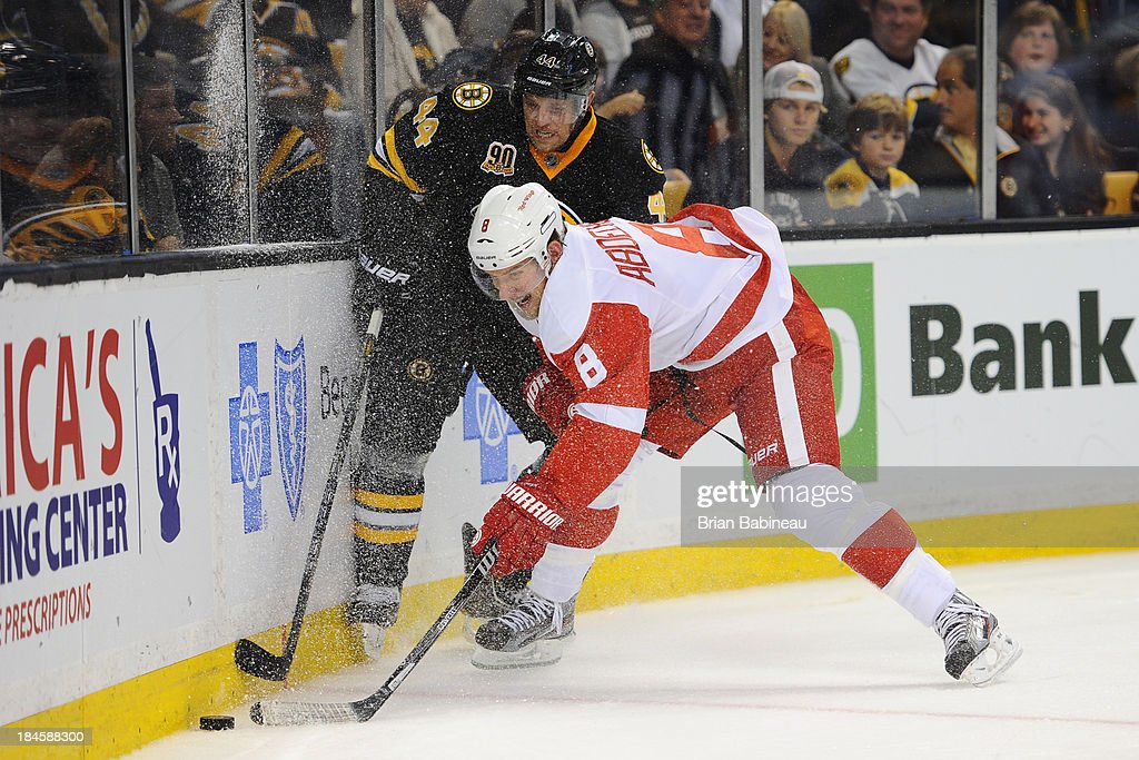 <a gi-track='captionPersonalityLinkClicked' href=/galleries/search?phrase=Justin+Abdelkader&family=editorial&specificpeople=2271858 ng-click='$event.stopPropagation()'>Justin Abdelkader</a> #8 of the Detroit Red Wings fights for the puck against <a gi-track='captionPersonalityLinkClicked' href=/galleries/search?phrase=Dennis+Seidenberg&family=editorial&specificpeople=204616 ng-click='$event.stopPropagation()'>Dennis Seidenberg</a> #44 of the Boston Bruins at the TD Garden on October 14, 2013 in Boston, Massachusetts.