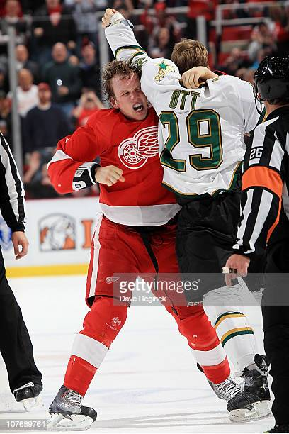 Justin Abdelkader of the Detroit Red Wings fights Steve Ott of the Dallas Stars during an NHL game at Joe Louis Arena on December 19 2010 in Detroit...