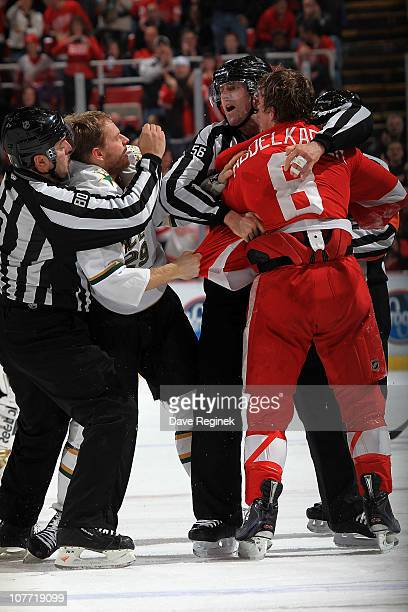 Justin Abdelkader of the Detroit Red Wings fights with Steve Ott of the Dallas Stars during an NHL game at Joe Louis Arena on December 19 2010 in...