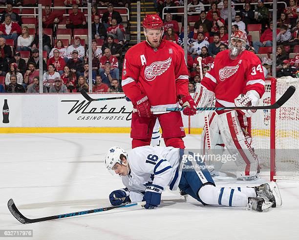 Justin Abdelkader of the Detroit Red Wings gets called for a hooking penalty on Mitch Marner of the Toronto Maple Leafs in front of goaltender Petr...