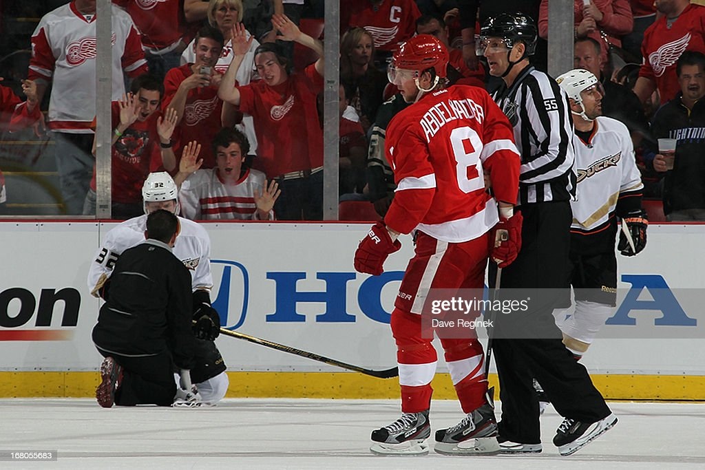 <a gi-track='captionPersonalityLinkClicked' href=/galleries/search?phrase=Justin+Abdelkader&family=editorial&specificpeople=2271858 ng-click='$event.stopPropagation()'>Justin Abdelkader</a> #8 of the Detroit Red Wings led off the ice by linesmen Shane Hayer after getting a 5 minute major and 10 minute misconduct penalty for his hit on <a gi-track='captionPersonalityLinkClicked' href=/galleries/search?phrase=Toni+Lydman&family=editorial&specificpeople=204145 ng-click='$event.stopPropagation()'>Toni Lydman</a> #32 of the Anaheim Ducks during Game Three of the Western Conference Quarterfinals at Joe Louis Arena on May 4, 2013 in Detroit, Michigan.