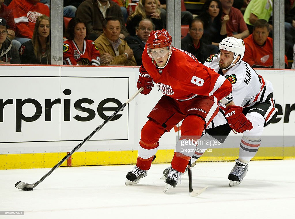 <a gi-track='captionPersonalityLinkClicked' href=/galleries/search?phrase=Justin+Abdelkader&family=editorial&specificpeople=2271858 ng-click='$event.stopPropagation()'>Justin Abdelkader</a> #8 of the Detroit Red Wings looks for a open teammate in front of <a gi-track='captionPersonalityLinkClicked' href=/galleries/search?phrase=Niklas+Hjalmarsson&family=editorial&specificpeople=2006442 ng-click='$event.stopPropagation()'>Niklas Hjalmarsson</a> #4 of the Chicago Blackhawks during the second period in Game Four of the Western Conference Semifinals during the 2013 NHL Stanley Cup Playoffs at Joe Louis Arena on May 23, 2013 in Detroit, Michigan. Detroit won the game 2-0 to take a 3-1 series lead.