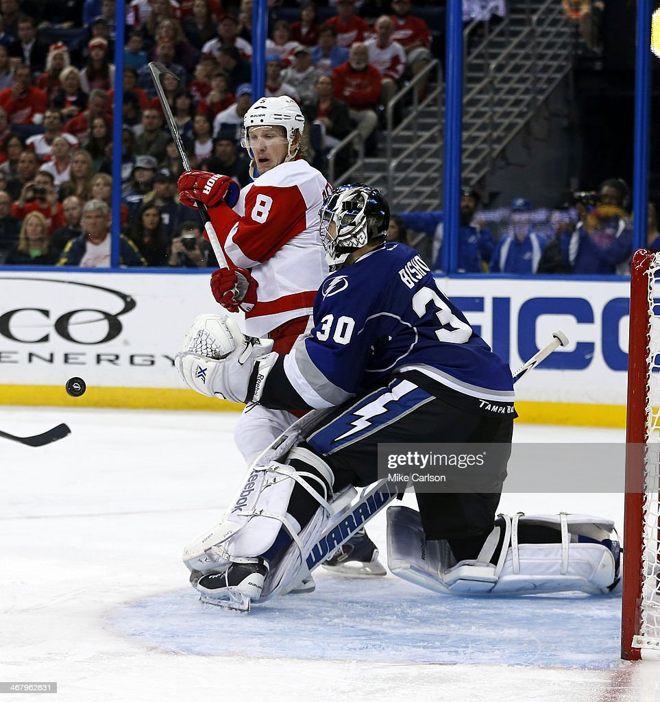 <a gi-track='captionPersonalityLinkClicked' href=/galleries/search?phrase=Justin+Abdelkader&family=editorial&specificpeople=2271858 ng-click='$event.stopPropagation()'>Justin Abdelkader</a> #8 of the Detroit Red Wings looks for a rebound in front of <a gi-track='captionPersonalityLinkClicked' href=/galleries/search?phrase=Ben+Bishop&family=editorial&specificpeople=700137 ng-click='$event.stopPropagation()'>Ben Bishop</a> #30 of the Tampa Bay Lightning at the Tampa Bay Times Forum on February 8, 2014 in Tampa, Florida.