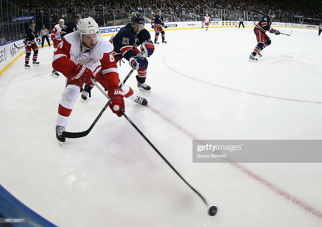 <a gi-track='captionPersonalityLinkClicked' href=/galleries/search?phrase=Justin+Abdelkader&family=editorial&specificpeople=2271858 ng-click='$event.stopPropagation()'>Justin Abdelkader</a> #8 of the Detroit Red Wings moves the puck around <a gi-track='captionPersonalityLinkClicked' href=/galleries/search?phrase=Derek+Stepan&family=editorial&specificpeople=4687181 ng-click='$event.stopPropagation()'>Derek Stepan</a> #21 of the New York Rangers during the third period at Madison Square Garden on January 16, 2014 in New York City. The Rangers shutout the Red Wings 1-0.