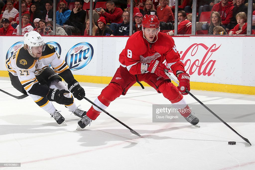 <a gi-track='captionPersonalityLinkClicked' href=/galleries/search?phrase=Justin+Abdelkader&family=editorial&specificpeople=2271858 ng-click='$event.stopPropagation()'>Justin Abdelkader</a> #8 of the Detroit Red Wings protects the puck as <a gi-track='captionPersonalityLinkClicked' href=/galleries/search?phrase=Dougie+Hamilton&family=editorial&specificpeople=6686524 ng-click='$event.stopPropagation()'>Dougie Hamilton</a> #27 of the Boston Bruins reaches in for it during an NHL game at Joe Louis Arena on November 27, 2013 in Detroit, Michigan. Detroit defeated Boston 6-1
