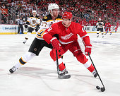 Justin Abdelkader of the Detroit Red Wings protects the puck from Dougie Hamilton of the Boston Bruins during Game Three of the First Round of the...
