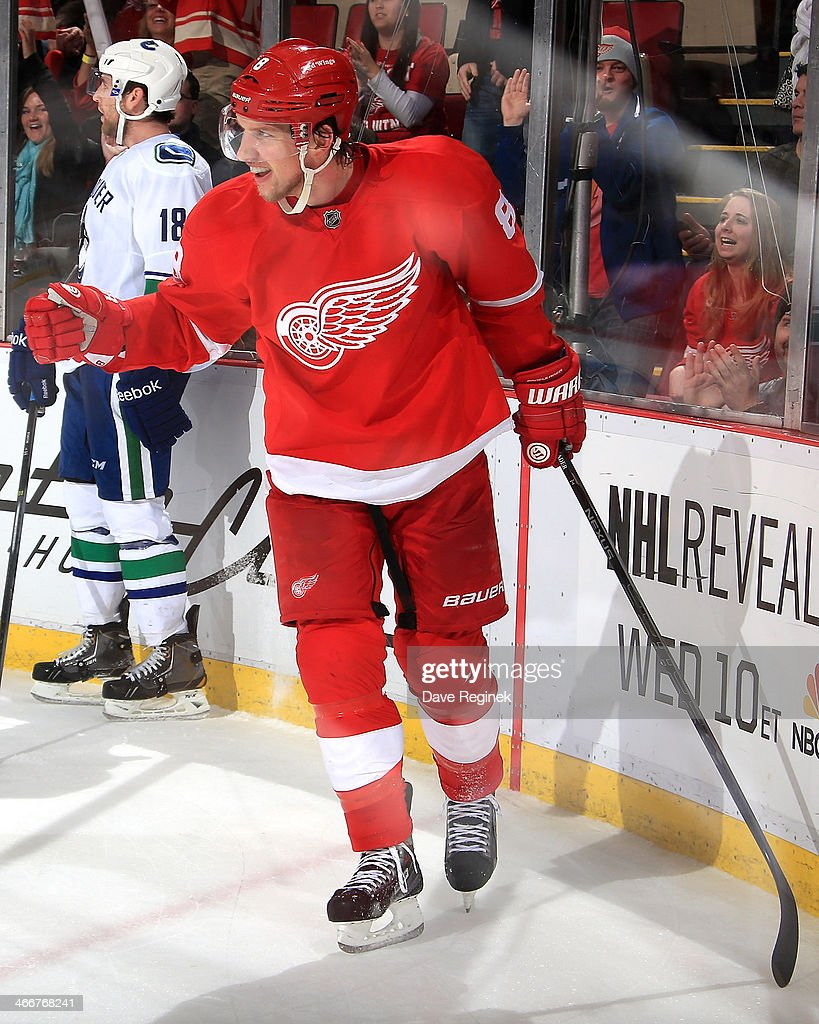<a gi-track='captionPersonalityLinkClicked' href=/galleries/search?phrase=Justin+Abdelkader&family=editorial&specificpeople=2271858 ng-click='$event.stopPropagation()'>Justin Abdelkader</a> #8 of the Detroit Red Wings pumps his fist after scoring his second goal on an empty net to seal the victory in an NHL game against the Vancouver Canucks on February 3, 2014 at Joe Louis Arena in Detroit, Michigan. Detroit defeated Vancouver 2-0.