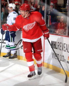 Justin Abdelkader of the Detroit Red Wings pumps his fist after scoring his second goal on an empty net to seal the victory in an NHL game against...