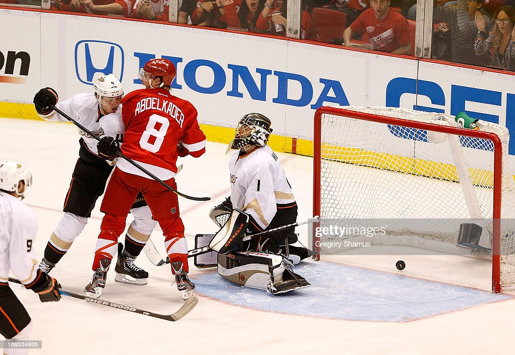 <a gi-track='captionPersonalityLinkClicked' href=/galleries/search?phrase=Justin+Abdelkader&family=editorial&specificpeople=2271858 ng-click='$event.stopPropagation()'>Justin Abdelkader</a> #8 of the Detroit Red Wings reacts to a goal by teammate Henrik Zetterberg #40 in overtime between <a gi-track='captionPersonalityLinkClicked' href=/galleries/search?phrase=Jonas+Hiller&family=editorial&specificpeople=743364 ng-click='$event.stopPropagation()'>Jonas Hiller</a> #1 and <a gi-track='captionPersonalityLinkClicked' href=/galleries/search?phrase=Cam+Fowler&family=editorial&specificpeople=5484080 ng-click='$event.stopPropagation()'>Cam Fowler</a> #4 of the Anaheim Ducks in Game Six of the Western Conference Quarterfinals during the 2013 NHL Stanley Cup Playoffs at Joe Louis Arena on May 10, 2013 in Detroit, Michigan. Detroit won the game 4-3 in overtime to tie the series at 3-3.