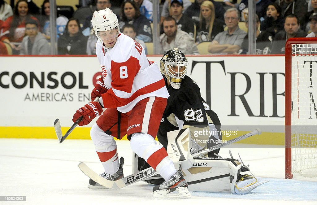 <a gi-track='captionPersonalityLinkClicked' href=/galleries/search?phrase=Justin+Abdelkader&family=editorial&specificpeople=2271858 ng-click='$event.stopPropagation()'>Justin Abdelkader</a> # 8 of the Detroit Red Wings screens goalie <a gi-track='captionPersonalityLinkClicked' href=/galleries/search?phrase=Tomas+Vokoun&family=editorial&specificpeople=202179 ng-click='$event.stopPropagation()'>Tomas Vokoun</a> # 92 of the Pittsburgh Penguins on a shot that went for a goal in the second period of a preseason game on September 16, 2013 at the CONSOL Energy Center in Pittsburgh, Pennsylvania.