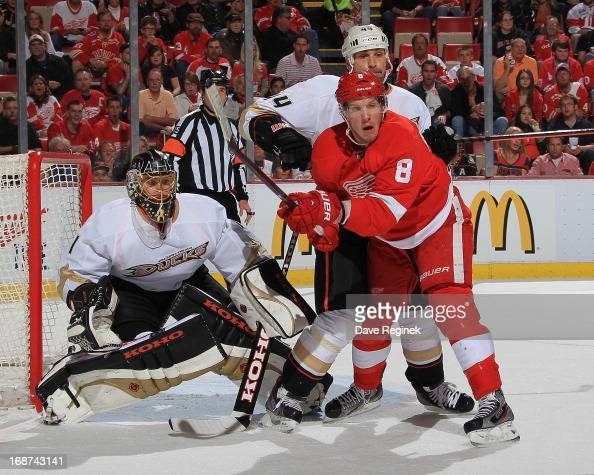 Justin Abdelkader of the Detroit Red Wings sets up in front of Jonas Hiller of the Anaheim Ducks as teammate Sheldon Souray defends during Game Six...