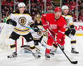 Justin Abdelkader of the Detroit Red Wings sets up in front of Tuukka Rask of the Boston Bruins as teammates Torey Krug and Kevan Miller defend...