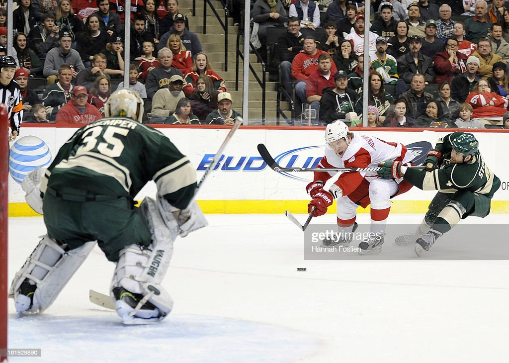 Justin Abdelkader #8 of the Detroit Red Wings shoots the puck at Darcy Kuemper #35 of the Minnesota Wild in net while Clayton Stoner #4 blocks the shot during the third period of the game on February 17, 2013 at Xcel Energy Center in St Paul, Minnesota. The Wild defeated the Red Wings 3-2.