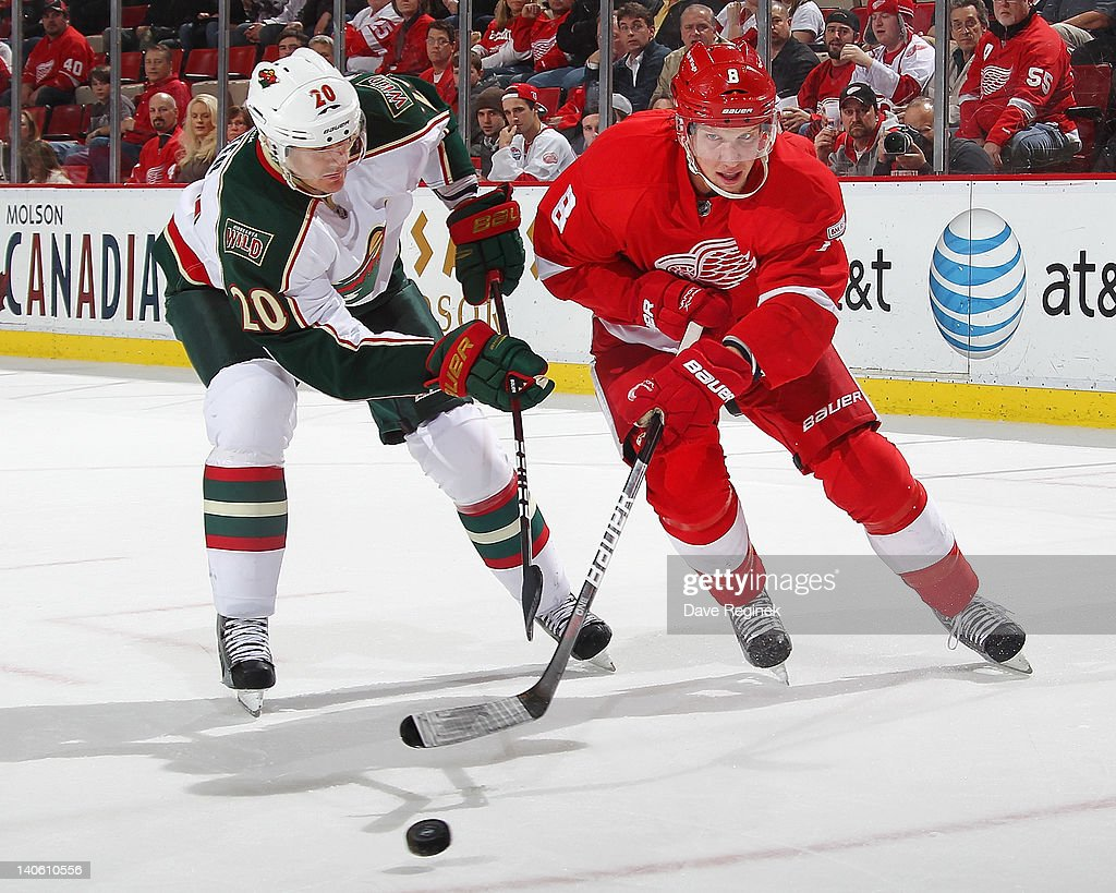 <a gi-track='captionPersonalityLinkClicked' href=/galleries/search?phrase=Justin+Abdelkader&family=editorial&specificpeople=2271858 ng-click='$event.stopPropagation()'>Justin Abdelkader</a> #8 of the Detroit Red Wings skates after the puck with Kurtis Foster #20 of the Minnesota Wild during an NHL game at Joe Louis Arena on March 2, 2012 in Detroit, Michigan. Wings win 6-0.
