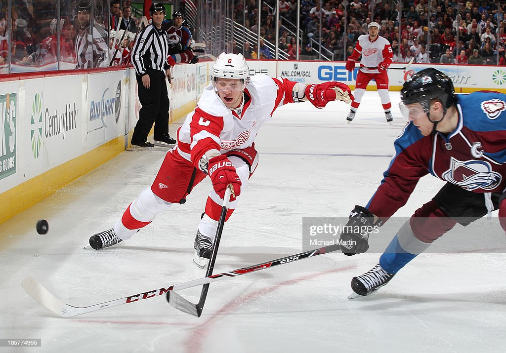 <a gi-track='captionPersonalityLinkClicked' href=/galleries/search?phrase=Justin+Abdelkader&family=editorial&specificpeople=2271858 ng-click='$event.stopPropagation()'>Justin Abdelkader</a> #8 of the Detroit Red Wings skates against <a gi-track='captionPersonalityLinkClicked' href=/galleries/search?phrase=Gabriel+Landeskog&family=editorial&specificpeople=6590816 ng-click='$event.stopPropagation()'>Gabriel Landeskog</a> #92 of the Colorado Avalanche at the Pepsi Center on April 5, 2013 in Denver, Colorado.
