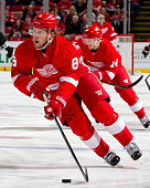 Justin Abdelkader of the Detroit Red Wings skates up ice with the puck during a NHL game against the Boston Bruins on April 2 2015 at Joe Louis Arena...