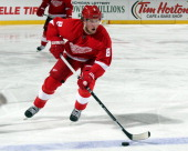 Justin Abdelkader of the Detroit Red Wings skates up ice with the puck against the Columbus Blue Jackets during a NHL game at Joe Louis Arena on...