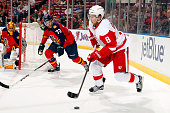 Justin Abdelkader of the Detroit Red Wings skates with the puck against Alex Petrovic of the Florida Panthers at the BBT Center on March 19 2015 in...