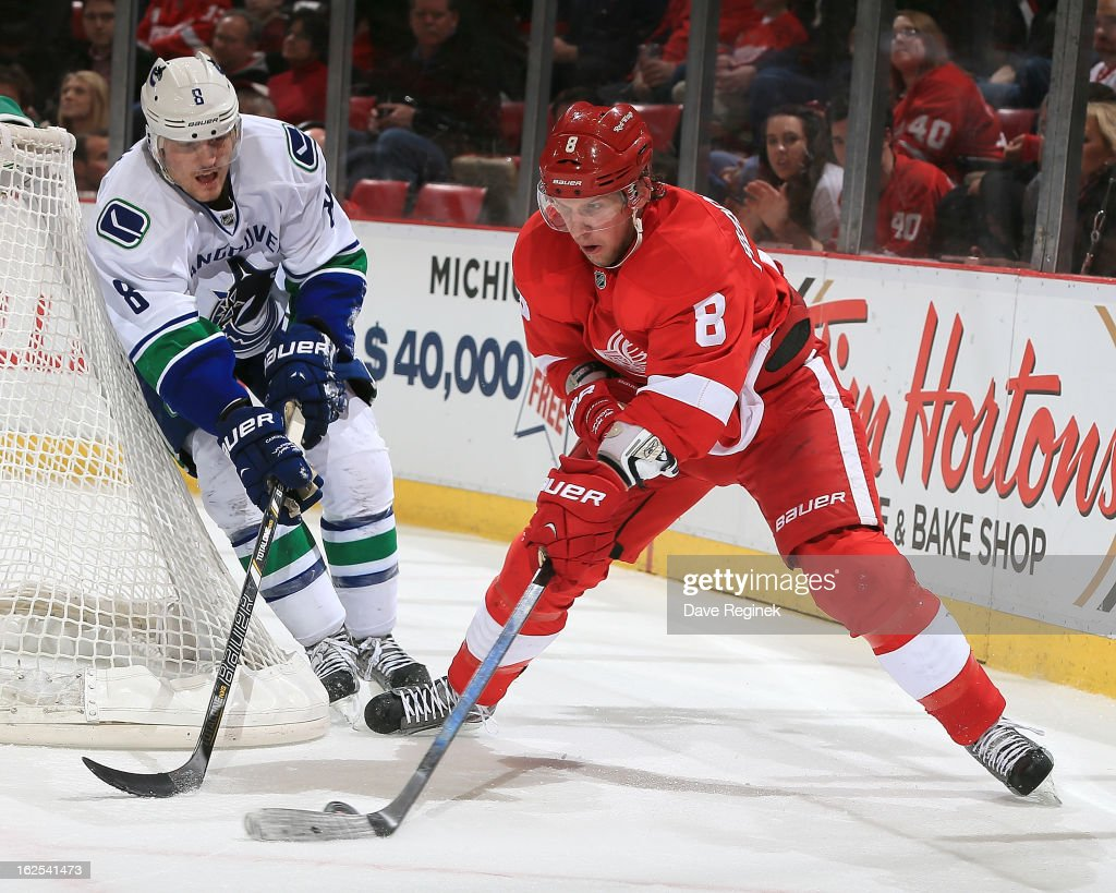 <a gi-track='captionPersonalityLinkClicked' href=/galleries/search?phrase=Justin+Abdelkader&family=editorial&specificpeople=2271858 ng-click='$event.stopPropagation()'>Justin Abdelkader</a> #8 of the Detroit Red Wings skates with the puck as <a gi-track='captionPersonalityLinkClicked' href=/galleries/search?phrase=Christopher+Tanev&family=editorial&specificpeople=7228624 ng-click='$event.stopPropagation()'>Christopher Tanev</a> #8 of the Vancouver Canucks gives chase during a NHL game at Joe Louis Arena on February 24, 2013 in Detroit, Michigan.